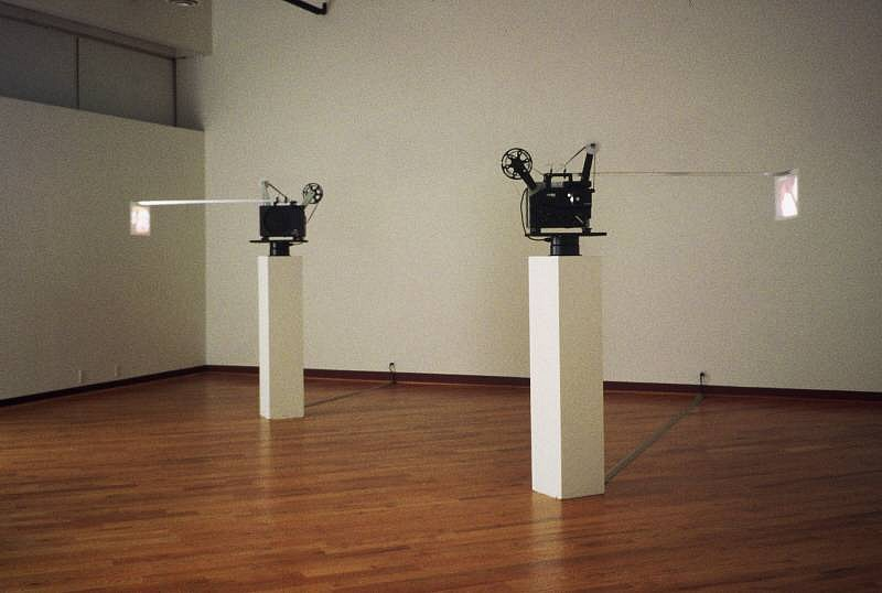 GIBSON + RECODER, VEHICULAR CIRCULAR 16mm double projection, ten-second 16mm film loops, motorized display units, hardware
